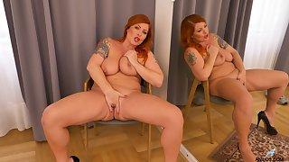 Big ass woman stands undressed and masturbates like a goddess