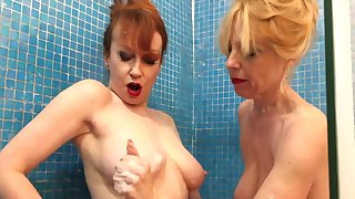 Red coupled with Lucy bonk their toys all over the shower