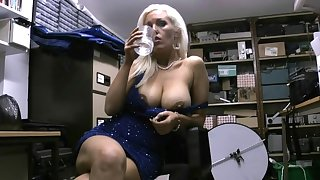 Busty blonde Rachel Travers likes to tease with her beamy tits