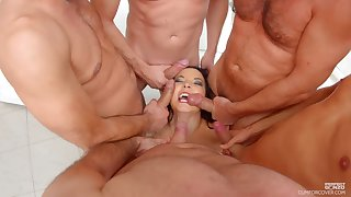 MILF Belle Francys in the first place her knees getting mouth fucked by a couple of females